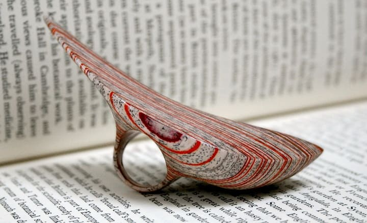 Laminated Jewelry Crafted from Vintage Books